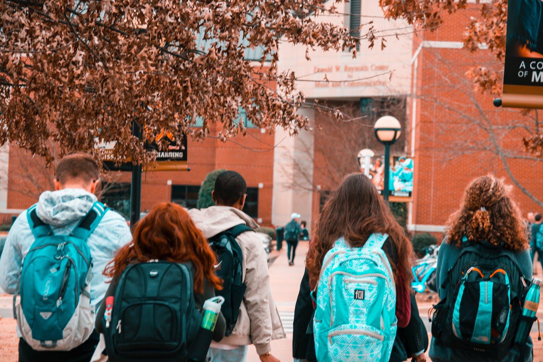 people wearing backpacks